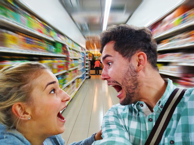 Wild shopping Couple Emotions Fun Funny Humor Man Sale Shopping Stress Woman Young Anger Argument Buy Crazy Customer  Discount Girl People Portrait Psychology Scream Shop Stressed Supermarket