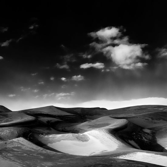 Scenic view of great sand dunes national park against sky during sunset