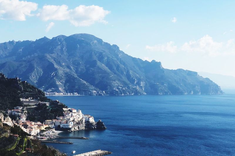Positano Amalfi Coast Salerno Campania Italy Water Mountain Sea Sky Scenics - Nature Beauty In Nature Nature Cloud - Sky Waterfront Built Structure Mountain Range Tranquility Land Plant Tranquil Scene Building Exterior Architecture Tree Day No People