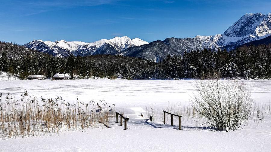 Bridge on a frozen lake, wintertime at mittenwald, lautersee, bavaria