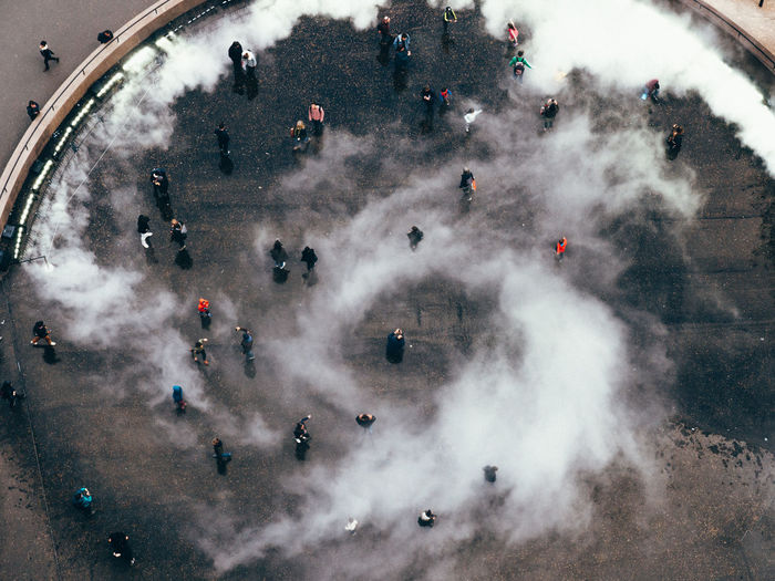 High Angle View Of People At Town Square During Foggy Weather