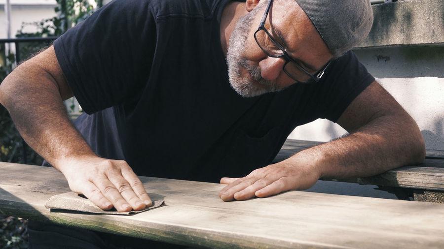 Man finishing furniture at workshop