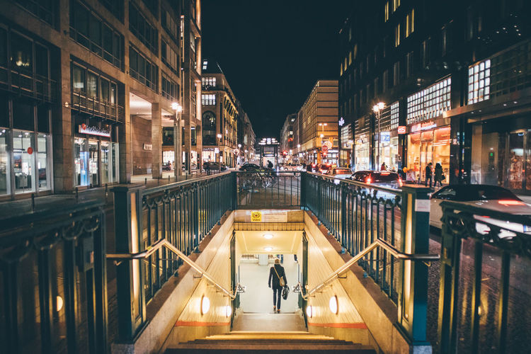 Illuminated Architecture Built Structure Building Exterior City Night Real People Building Men Lifestyles Women Street Group Of People City Life The Way Forward Direction Transportation People Incidental People Adult Outdoors Canal