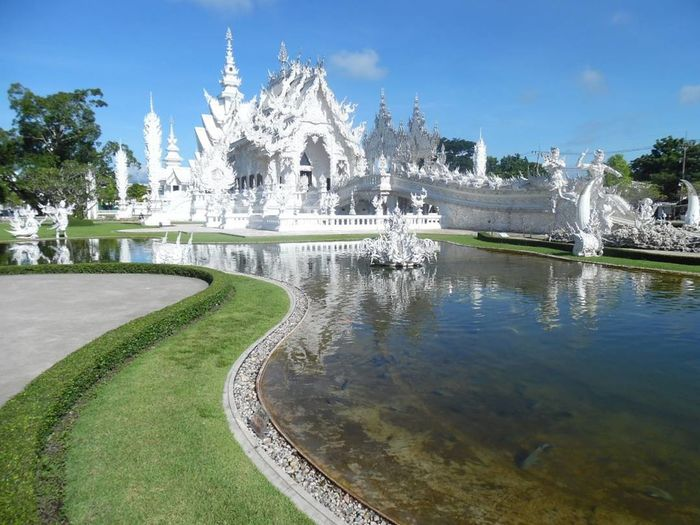 amazing white temple in Chiang Rai Thailand Chiangrai Thailandtravel Traveller Travel Paradise Cool White Visit Tourist Tourism Visitors August Holliday Vacation ASIA Norththailand Temple Whitetemple Amazing Ornate Tree Architecture Day Beauty Statue No People Outdoors Mountain Nature EyeEmNewHere Fashion Stories This Is Masculinity