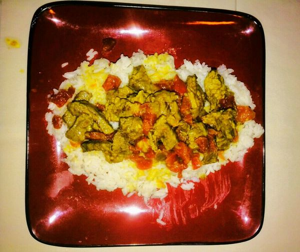 Curry curried beef with diced tomatoes and green chilis Tomatoes From My Garden , Nature Tomatoes Flavor Flavorful Flavorforfood No People Food Food Photography Secret Recipe Secret Recipes Dinner Dinner Time Beef Rice - Food Staple Spicy Food Red Red Plate Square Plate Good Eats