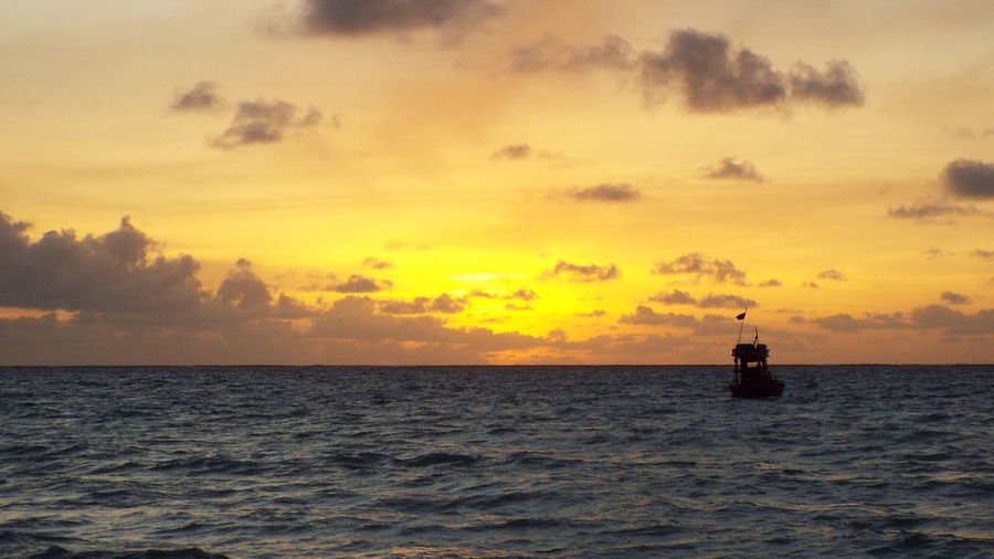 Water Sea Sunset Sky Horizon Over Water Horizon Transportation Scenics - Nature Cloud - Sky Nautical Vessel Beauty In Nature Orange Color Mode Of Transportation Nature Waterfront Silhouette Tranquil Scene Tranquility Idyllic No People Outdoors