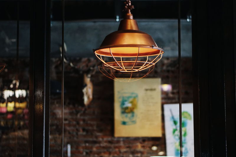 Close-up of illuminated light hanging from ceiling