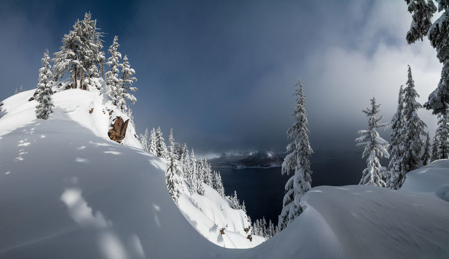 Panorama of Crater Lake in Oregon, USA as a winter storm clears. Crater Lake High Resolution Hiking National Park Nature Oregon Panorama Travel Trees USA Winter Clouds Color Lake Landsape Mountain Scenics Snow Snow Covered Snowcapped Mountain Tousism Winter Wonderland