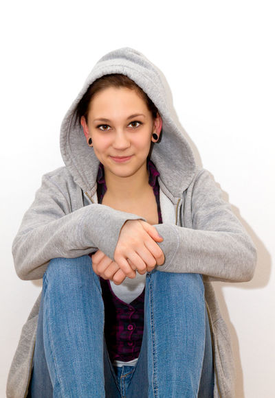 Young woman in a gray hoodie sitting on the floor Beautiful Fashion Females Happiness Happy Student Woman Beauty Clothing Education Girl Happiness Healthy Hood Hood - Clothing Hoodie Lifestyles People Portrait Psychology School Sitting Smiling Young Adult Young Women