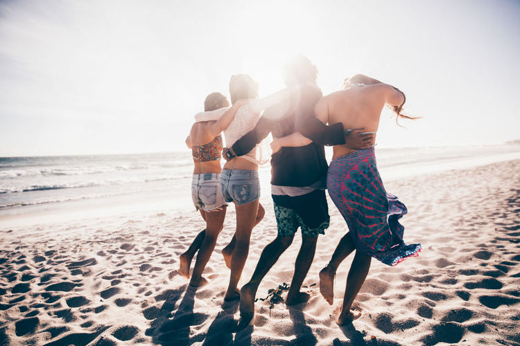 Beach Sea Water Group Of People Togetherness Sand Leisure Activity Nature Men Full Length Friendship Holiday Sunlight Trip Vacations Sky Bonding Lifestyles Adult Outdoors