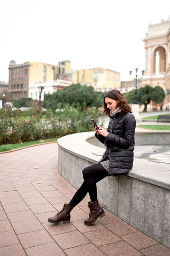 Pretty woman sitting with phone person