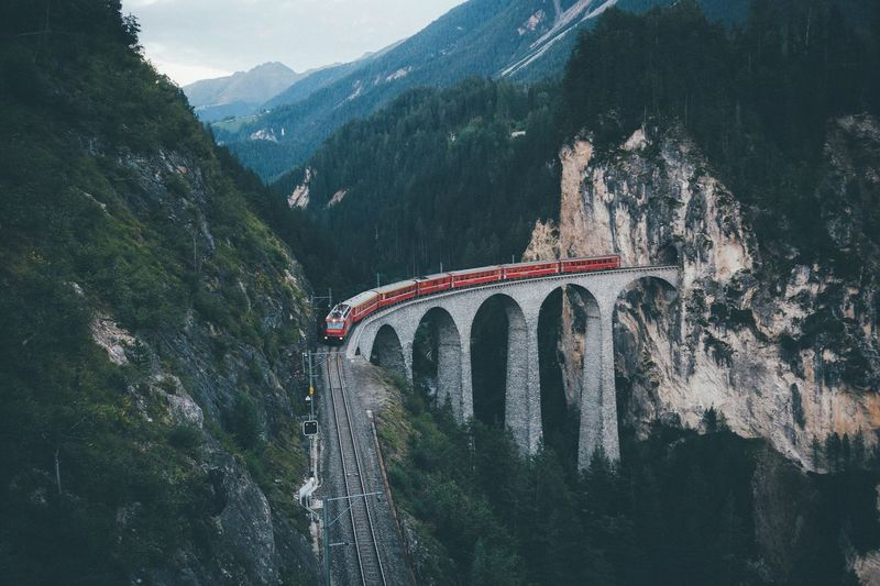 Early mornings at Landwasser VSCO Vscofilm Sunrise Switzerland Mountain Connection Bridge - Man Made Structure Built Structure Arch Architecture Arch Bridge Bridge Nature Mountain Range Outdoors Stream Scenics Day Rocky Non-urban Scene Tranquility Tranquil Scene Beauty In Nature Arched