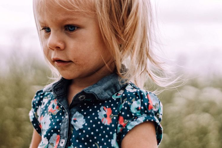 EyeEm Selects portrait of little girl with messy face Childhood One Person Blond Hair Focus On Foreground Headshot Real People Looking At Camera Outdoors Portrait Day Close-up Girls One Girl Only Standing Child Children Only Nature Sky People Adult Fresh On Market 2017
