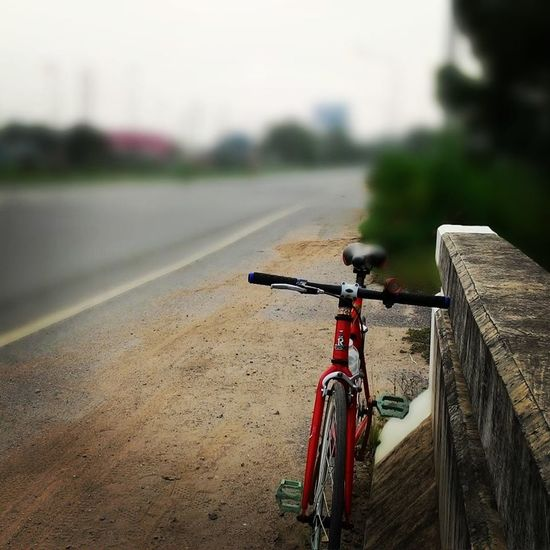#journey #ride #travel Architecture Bicycle City Close-up Day Focus On Foreground Handlebar Land Vehicle Metal Mode Of Transportation Nature No People Outdoors Plant Railing Road Stationary Street Transportation Travel Wheel