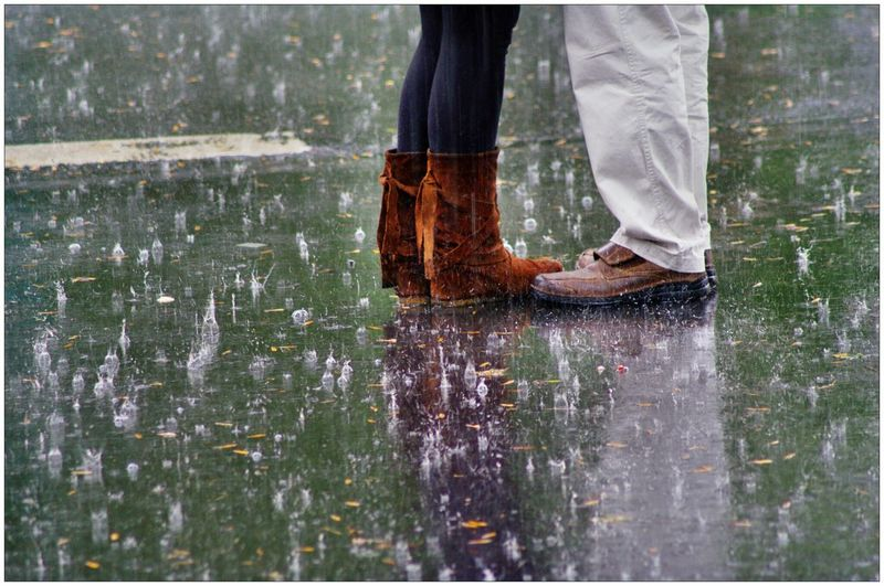 Low section of a couple standing in rain