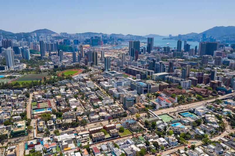 Aerial view of city buildings against sky