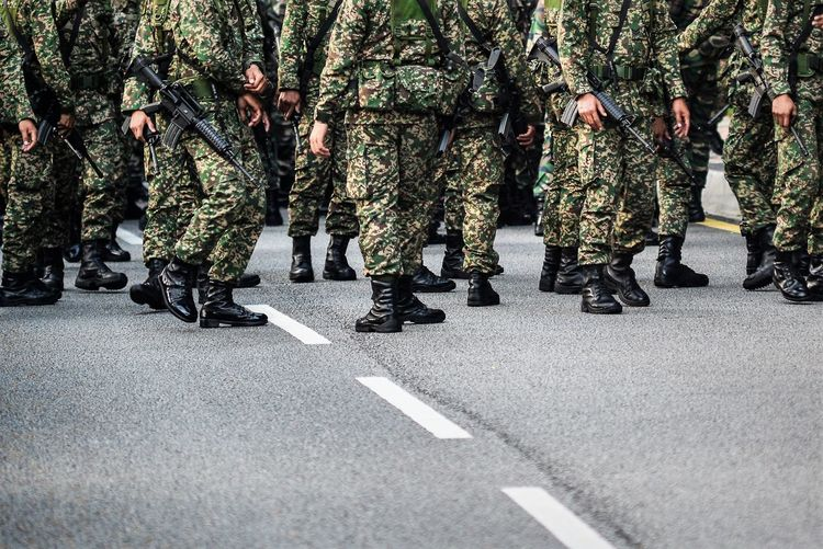 Army soldiers with rifle during parade
