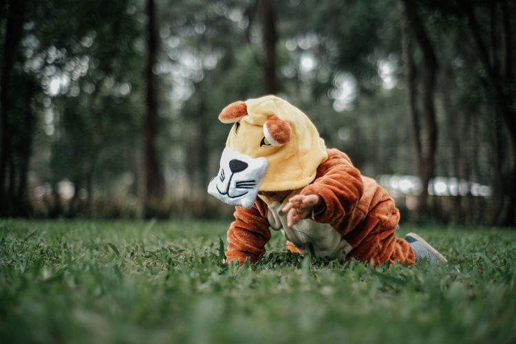 Kid with pajama costume on the field.