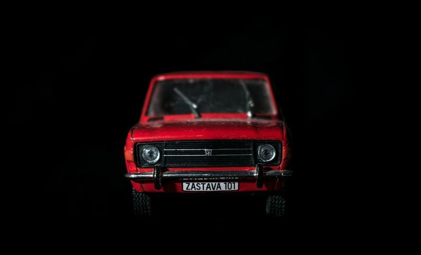 Close-up of toy car against black background