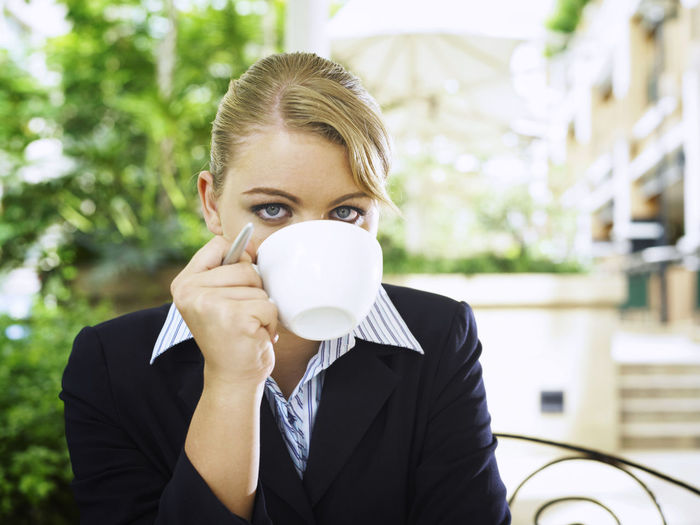 Portrait Of Young Businesswoman Drinking Coffee