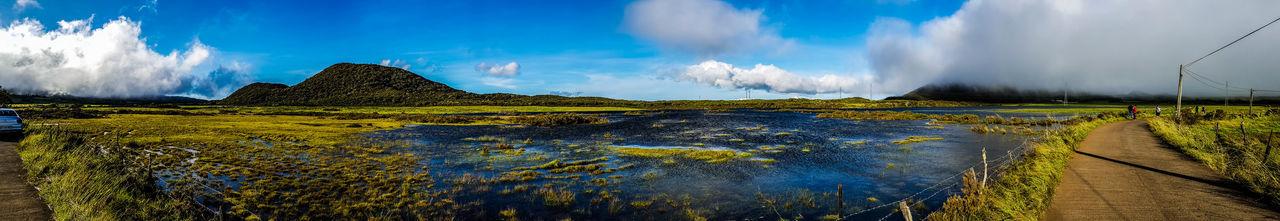 Lac éphémère à la plaine des cafres Dumazile People Watching Reunion Island Beauty In Nature Cloud - Sky Day Ephemeral Grass Hurricane Lac Lake Landscape Mountain Nature No People Outdoors People Plaine Des Cafres Scenics Sky Water éphémère