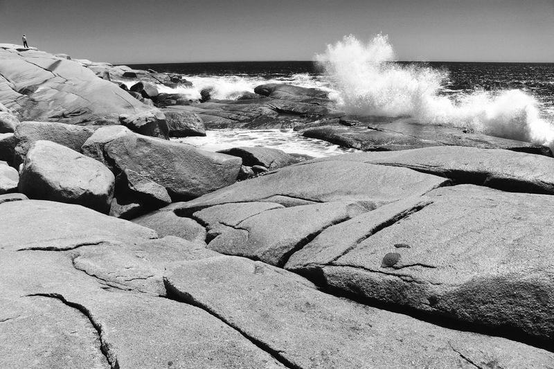 Nova Scotia, Canada Person Watching Waves Small Figure In Landscape Waves Splashing Up On Rocks Black And White Coast Coastal Rocks Man And Sea Power In Nature