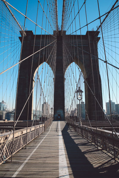 Architecture Bridge - Man Made Structure Brooklyn Bridge  Brooklyn Bridge / New York Built Structure City Cold Connection Day New York New York City No People Outdoors Sky Steel Cable Sunny Suspension Bridge Tourism Transportation Travel Travel Destinations Winter