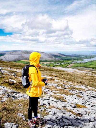 Hiking the Burren with Shins 🚶 Adventure Backpack Beauty In Nature County Clare Day Full Length Hiker Hiking Ireland Landscape Leisure Activity Lifestyles Mountain Nature One Person Outdoors Real People Yellow Jacket Scenics Sky Slimshinny The Burren Travel Vacations The Great Outdoors - 2017 EyeEm Awards Breathing Space Paint The Town Yellow Lost In The Landscape