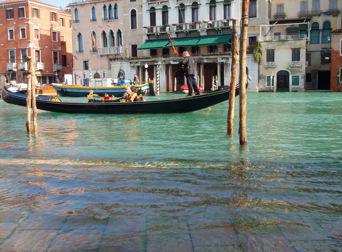 Acqua Alta Adult Adults Only Architecture Building Exterior Built Structure Canal Cultures Day Gondola Gondola - Traditional Boat Gondolier Grand Canal High Water Large Group Of People Mode Of Transport Nautical Vessel Outdoors People Tourism Transportation Travel Travel Destinations