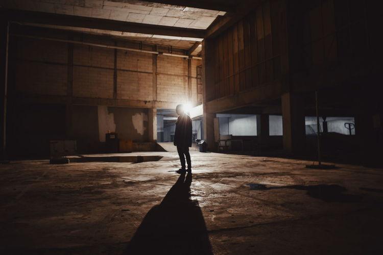 Full length of silhouette man standing in basement