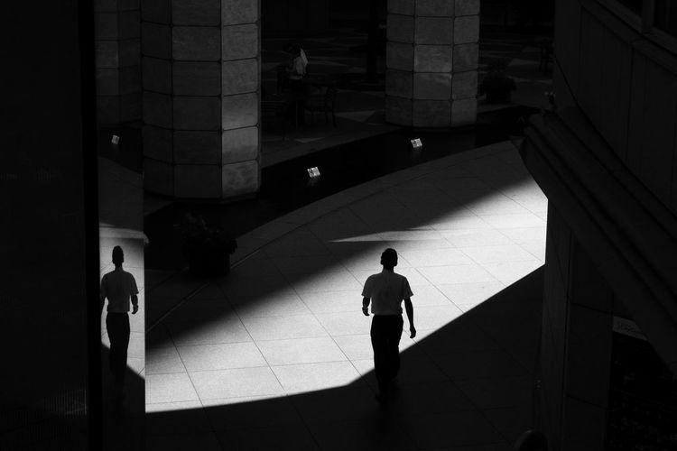 Silhouette of man walking in office building