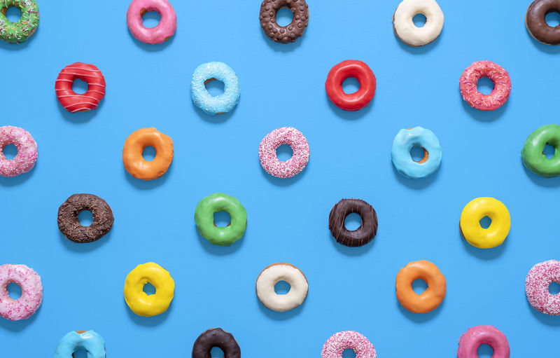 Full frame shot of multi colored candies against blue background