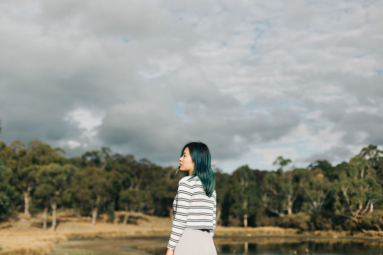 One Person Real People Standing Cloud - Sky Lifestyles Sky Leisure Activity Nature Land Field Young Adult Casual Clothing Plant Women Day Adult Young Women Beauty In Nature Outdoors Hairstyle Beautiful Woman Contemplation People Portrait Travel The Traveler - 2019 EyeEm Awards