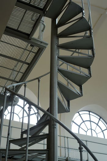 Ironwork  Spiral Stairs Architecture Building Built Structure Ceiling Corkscrew Stairs Day Indoors  Lighting Equipment Low Angle View Metal Modern Nature No People Pattern Railing Sky Skylight Sunlight Time Window