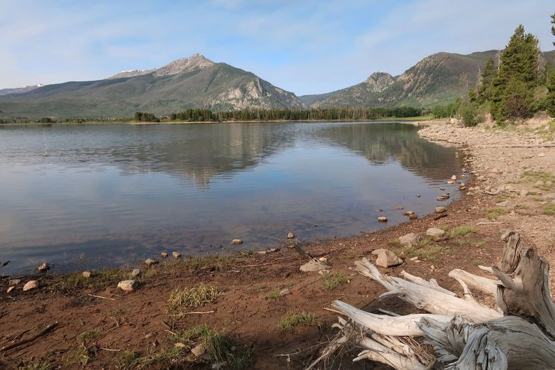 Landscape of lake shore and mountains in Dillon, Colorado Dillon Reservoir Colorado Mountians Colorado Water Sky Mountain Beauty In Nature Tranquility Scenics - Nature Tranquil Scene No People Plant Lake Reflection Beach Tree Outdoors Cloud - Sky Land Day Nature Non-urban Scene