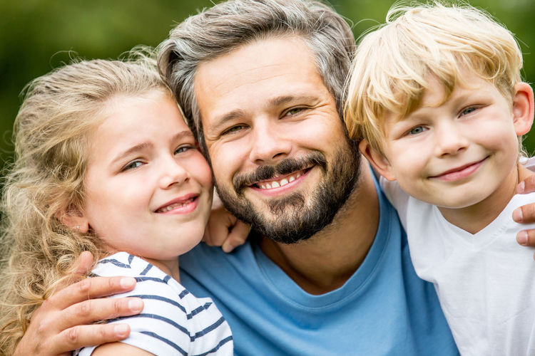 Portrait Of Smiling Family At Park