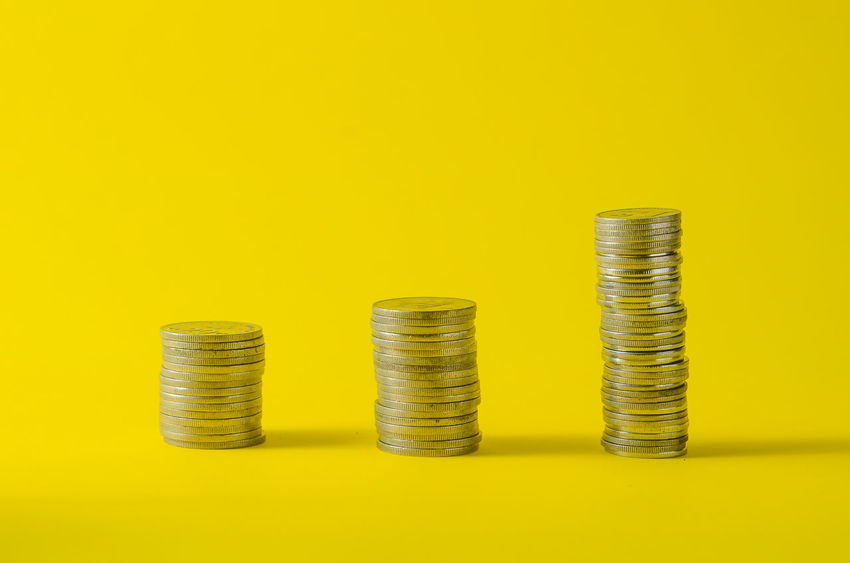 Business Business Finance And Industry Coin Colored Background Copy Space Currency Economy Finance Gold Colored Indoors  Investment Large Group Of Objects Making Money No People Savings Side By Side Silver Colored Stack Still Life Studio Shot Wealth Yellow