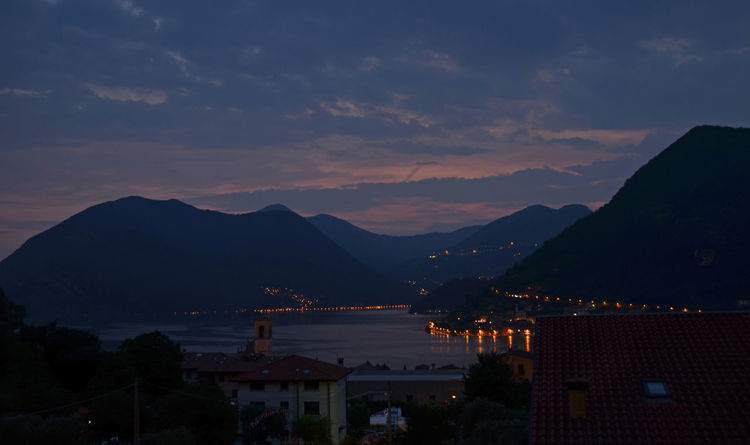 Atmosphere Lago D'Iseo Monte Isola Beauty In Nature Cloud - Sky Evening Mountain Mountain Range No People Scenics - Nature Sky Sulzano Sunset Water
