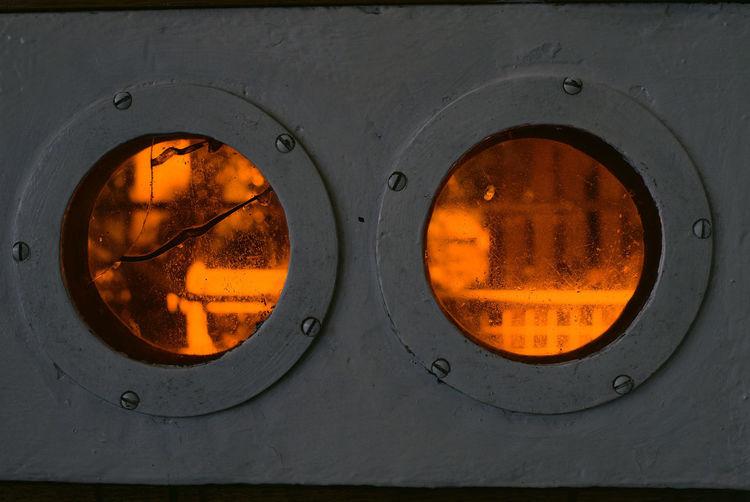 Türfenster im Haus Schminke Haus Schminke Löbau Appliance Audio Equipment Backgrounds Circle Close-up Design Equipment Full Frame Geometric Shape Germany Indoors  Industry Machinery Metal Modern Music No People Orange Color Saxony Shape Technology