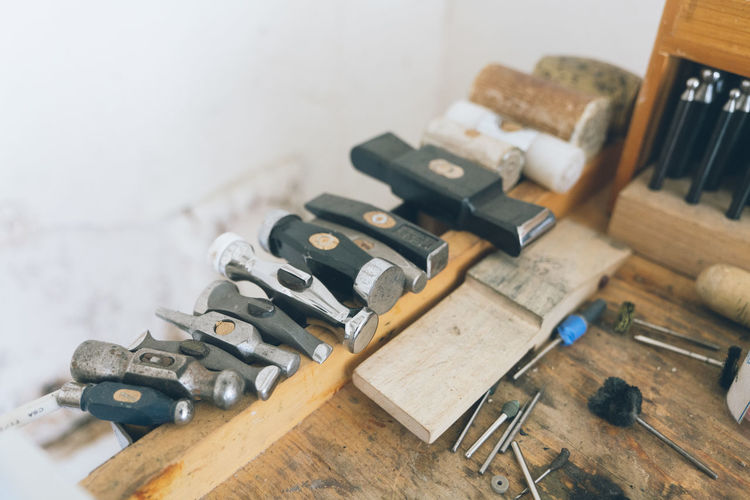 High angle view of old tools on table