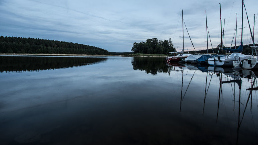 Beauty In Nature Cloud - Sky Day Lake Mode Of Transportation Nature Nautical Vessel No People Outdoors Plant Reflection Sailboat Scenics - Nature Sky Tranquil Scene Tranquility Transportation Tree Water Waterfront