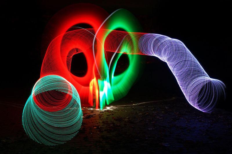 Illuminated Light Painting Against Black Background