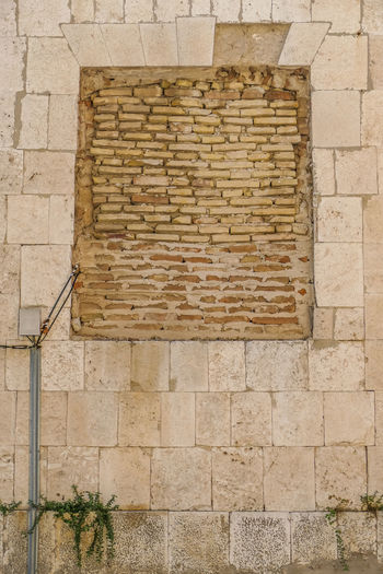 Architecture Built Structure Wall Wall - Building Feature Brick Building Exterior Brick Wall No People Day Pattern Outdoors Building Stone Wall Stone Material Window Textured  Tile Old City Footpath