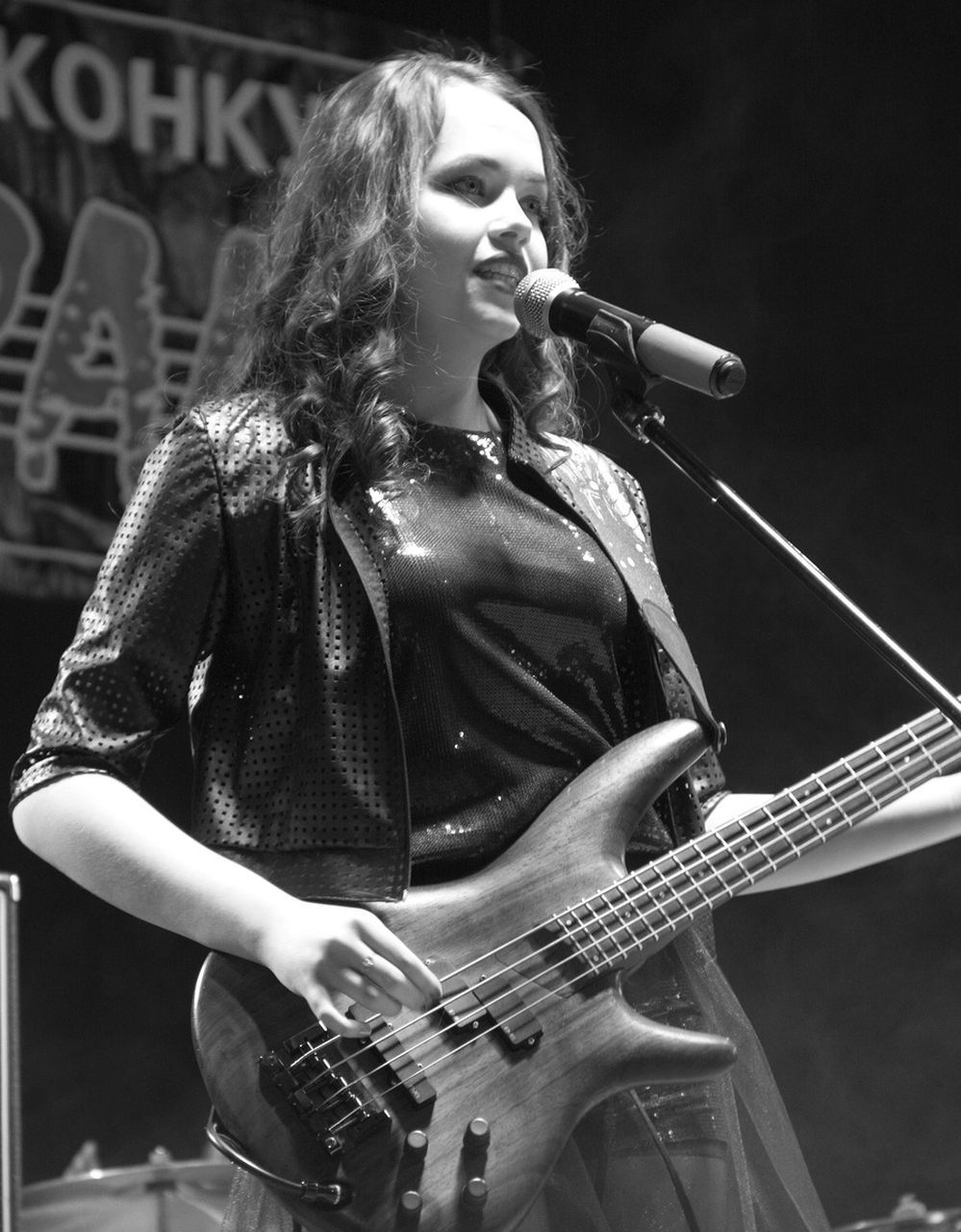 music, arts culture and entertainment, real people, one person, musical instrument, leisure activity, lifestyles, musician, standing, singing, performance, playing, stage - performance space, guitar, singer, microphone, rock musician, outdoors, electric guitar, young women, young adult, day, people