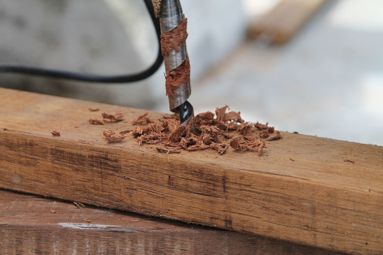 Close-up of drill on wood