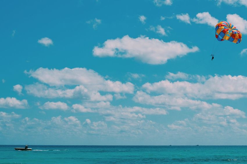 Summer Views Summer Photography Sky Blue Sky Blue Ocean Waves Wave Parasailing Paradise Clouds Boat Boats