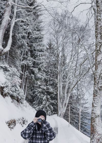 Photographer Tree Flumserberg Winter Snow Cold Temperature Weather Real People Leisure Activity Nature One Person Bare Tree Warm Clothing Tree Lifestyles Day Outdoors Beauty In Nature Men Shades Of Winter