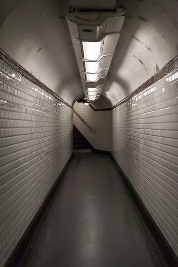 Illuminated tunnel at subway station
