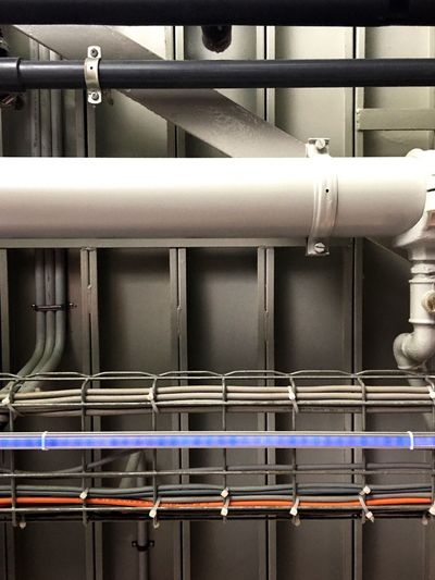 Low angle view of pipes in factory