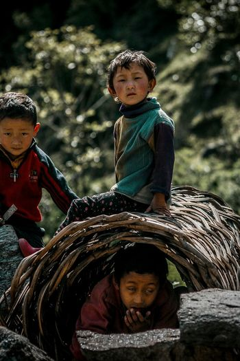 Hide and Seek, You're lucky I was on that roof all day EyeEm Best Shots Portrait Zimithang Cheerful Arunachal Pradesh Trekking Travel Warm Clothing Green Happiness Kids Kidsphotography Kids Playing Portrait Photography Portraits Of EyeEm Autumn Mood Human Connection Capture Tomorrow Moments Of Happiness It's About The Journey